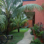 The garden and bicycles of Hotel Villa Matisse Tulum